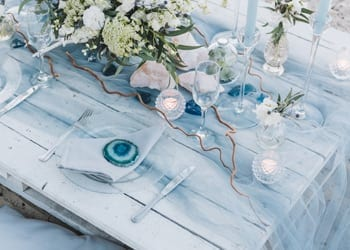 Ocean-themed wedding reception table at a beach-themed wedding