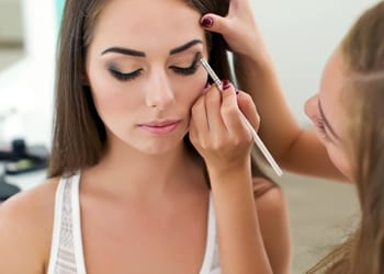 A bride-to-be having her makeup applied during a makeup trial