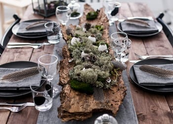 A rustic-themed wedding reception table setting