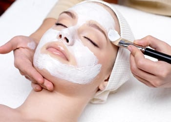 A bride-to-be preparing for her wedding by receiving a facial