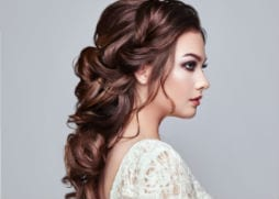 brides hair back with loose curls
