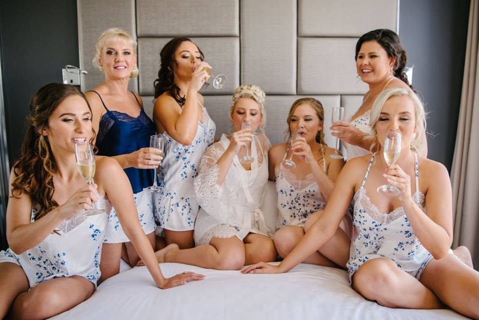 girls drinking champagne on wedding day