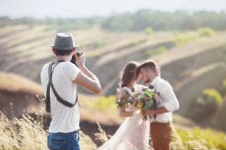 Wedding photographer taking photos of bride and groom