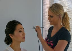 Sarah applying airbrush makeup